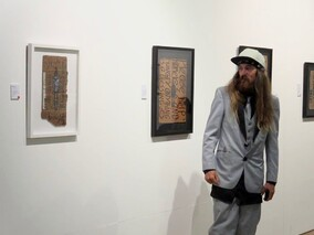 Artist Milarky next to his works at Percy Thomson Gallery