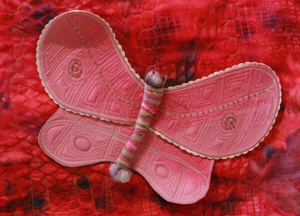 Pink textile art, with butterfly