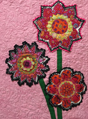 Pink textile art with flowers