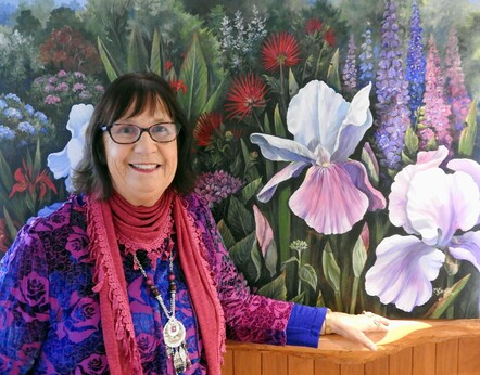 Taranaki artist Margaret Scott with large floral painting