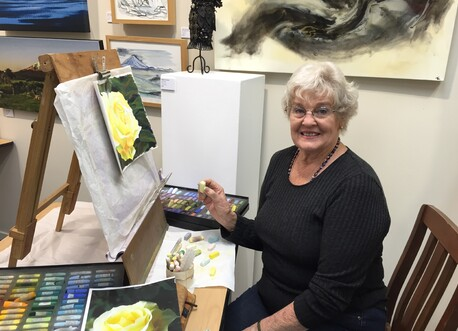 Pastel artist Judith White working on a portrait of this yellow rose in our gallery art store, Percy's Place.