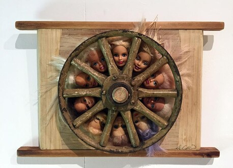 Class of 2012 - Dale Copeland, Barbie doll heads, old wooden wheel, on chopping board. 'It feels wrong when the beautiful and young go under' $920