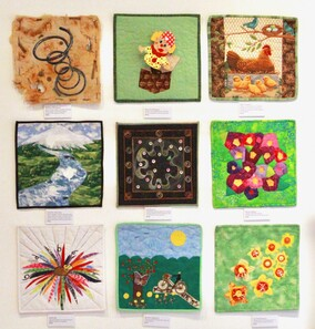 Selection of art quilts in the 12x12 Taranaki Patchworkers and Quilters Challenge